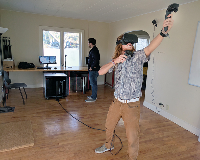 Another student testing virtual reality system